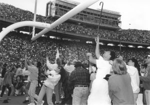 Student throwing their canes over the goal post.