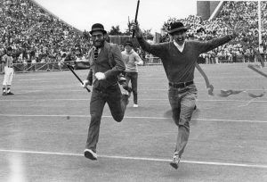 Student running across the Camp Randall field in 1981.