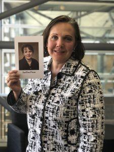 SanDee Priser '02 holds her UW Law graduation photo